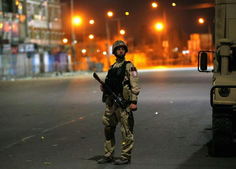 An Afghan security personnel keeps watch near the Serena hotel, during an attack in Kabul March 20, 2014. REUTERS/Ahmad Masood