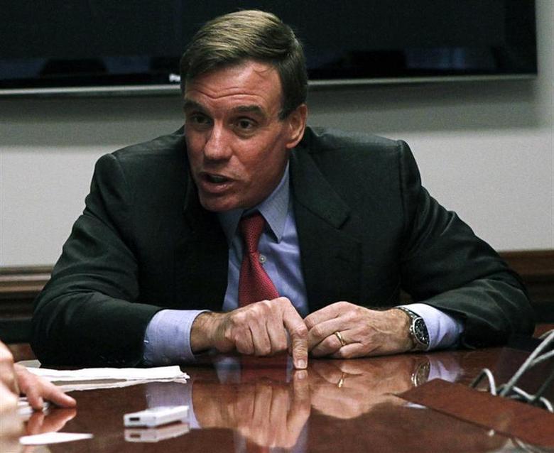 U.S. Senator Mark Warner speaks during an interview with Reuters in Washington, November 20, 2012. REUTERS/Stelios Varias