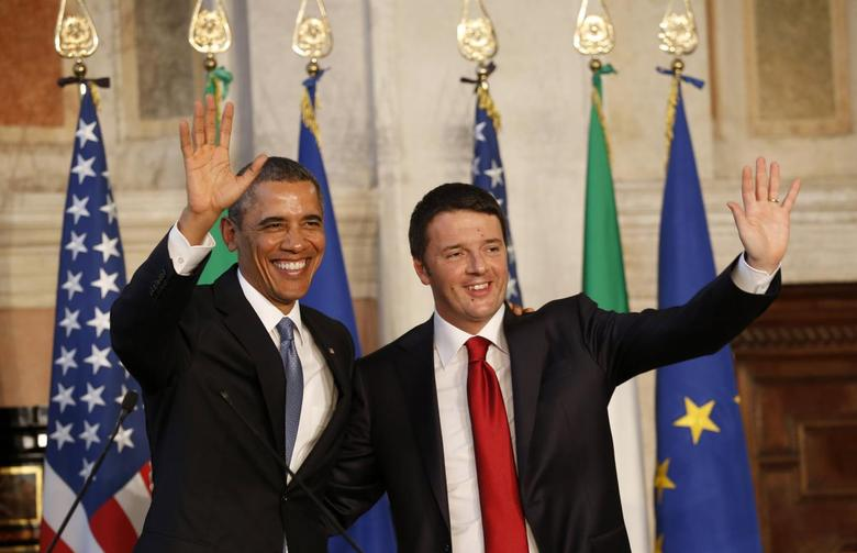 U.S. President Barack Obama and Italian Prime Minister Matteo Renzi wave at the end of their conference following their meeting at Villa Madama in Rome March 27 2014. REUTERS/Kevin Lamarque