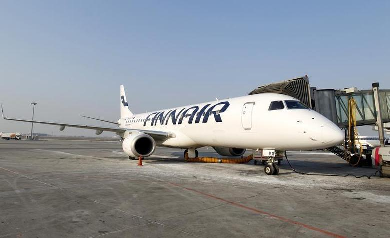 A Finnair airplane is docked at the Chopin International Airport in Warsaw February 6, 2012. REUTERS/Peter Andrews