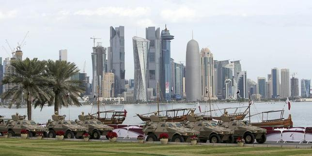 Members of the Qatari Armed Forces travel in armoured personnel carriers (APCs) during National Day celebrations in Doha December 18, 2012. REUTERS/Fadi Al-Assaad