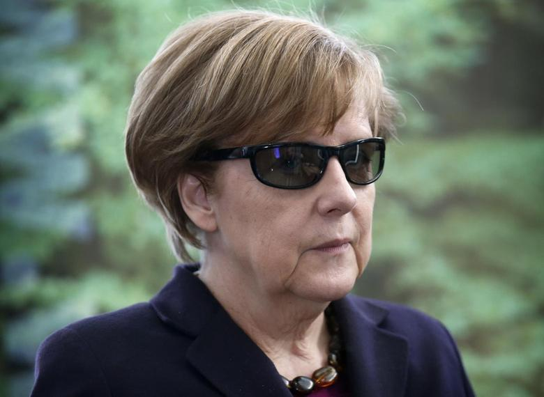 German Chancellor Angela Merkel wears 3D glasses during a visit by teenage female students on national 'Girls Day', at the Chancellery in Berlin March 26, 2014. REUTERS/Fabrizio Bensch