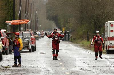 US mudslide death toll expected to soar as survivors...