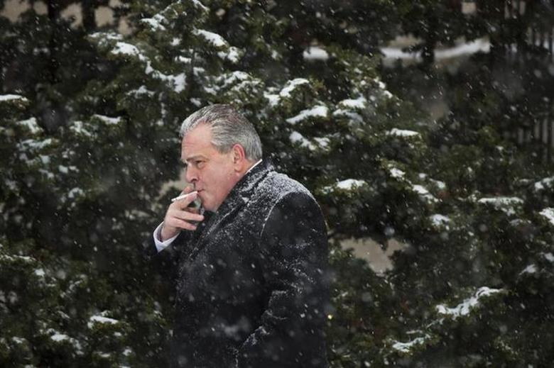 A man smokes outside the Patriots Theater at the War Memorial in Trenton, New Jersey January 21, 2014. REUTERS/Lucas Jackson/Files