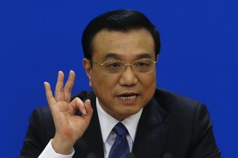 China's Premier Li Keqiang gestures as he speaks during a news conference, after the closing ceremony of the Chinese National People's Congress (NPC) at the Great Hall of the People, in Beijing, March 13, 2014. REUTERS/Barry Huang/Files