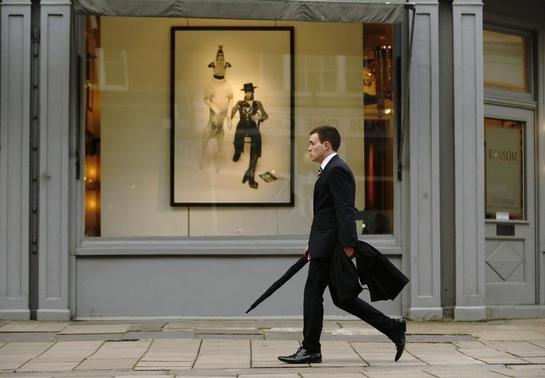 A man passes a gallery in London March 25, 2014. REUTERS/Luke MacGregor