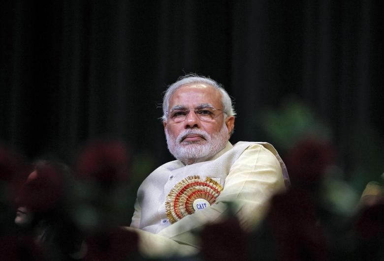 Hindu nationalist Narendra Modi, prime ministerial candidate for India's main opposition Bharatiya Janata Party (BJP) and Gujarat's chief minister, attends the Confederation of All India Traders (CAIT) national convention in New Delhi in this February 27, 2014 file photo. REUTERS/Stringer/Files