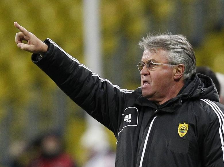 Anzhi Makhachkala's coach Guus Hiddink gestures during his teams Europa League soccer match against Newcastle United at the Luzhniki stadium in Moscow, March 7, 2013. REUTERS/Maxim Shemetov