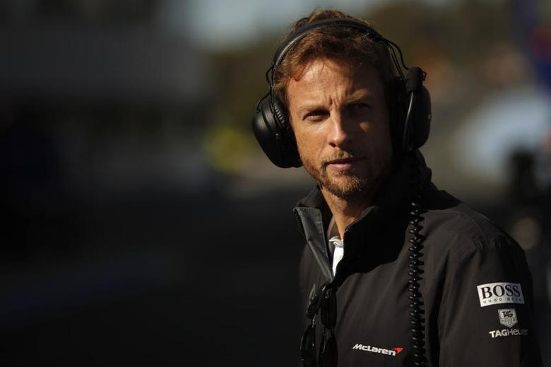 McLaren Formula One driver Jenson Button of Britain stands in the pit lane during pre-season testing at the Jerez racetrack in southern Spain January 30, 2014. REUTERS/Jon Nazca