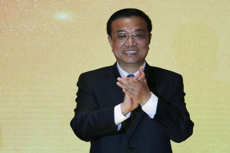 Chinese Vice Premier Li Keqiang attends the launch ceremony of RMB sovereign bonds in Hong Kong August 17, 2011. REUTERS/Tyrone Siu