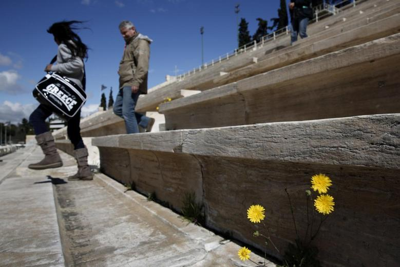 Tourists visit the Panathenean stadium, the stadium which hosted the first modern Olympics in 1896, in Athens March 11, 2014. REUTERS/Yorgos Karahalis