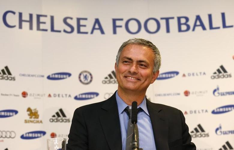 Newly reappointed Chelsea manager Jose Mourinho reacts during a news conference at Stamford Bridge stadium in London June 10, 2013. REUTERS/Suzanne Plunkett