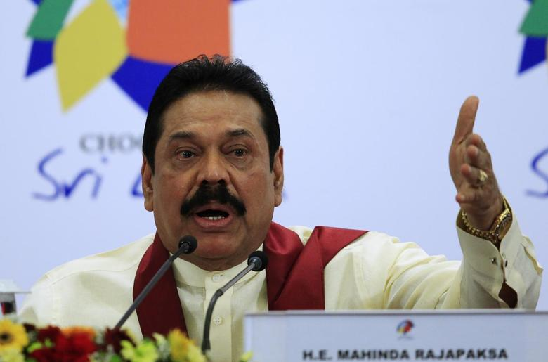 Sri Lankan President Mahinda Rajapaksa gestures as he speaks during a news conference at the Commonwealth Heads of Government Meeting (CHOGM) in Colombo November 17, 2013. REUTERS/Dinuka Liyanawatte