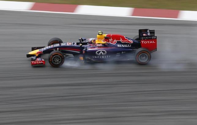 Red Bull Formula One driver Daniel Ricciardo of Australia drives during the first practice session of the Malaysian F1 Grand Prix at Sepang International Circuit outside Kuala Lumpur, March 28, 2014. REUTERS/Samsul Said