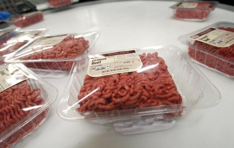One pound packages of ground beef is seen on a round table to be put into crates at the Fresh & Easy Neighborhood Market meat processing facility in Riverside, California March 29, 2012. REUTERS/Alex Gallardo