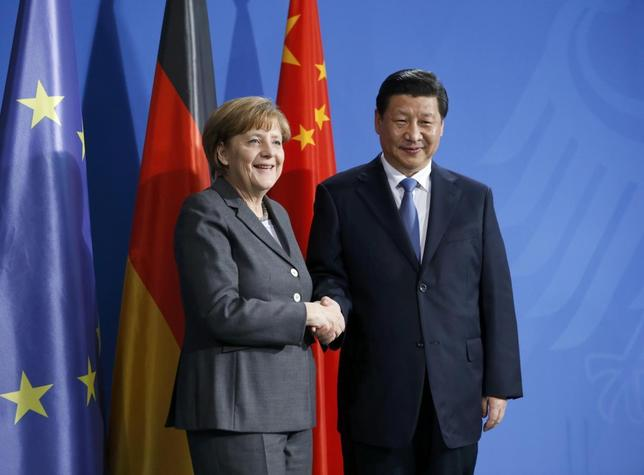German Chancellor Angela Merkel and China's President Xi Jinping shakes hands following a joint news conference after an agreement signing, at the Chancellery in Berlin March 28, 2014. REUTERS/Fabrizio Bensch