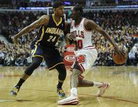 Mar 24, 2014; Chicago, IL, USA; Chicago Bulls guard Tony Snell (20) is defended by Indiana Pacers forward Paul George (24) during the first half at the United Center. David Banks-USA TODAY Sports