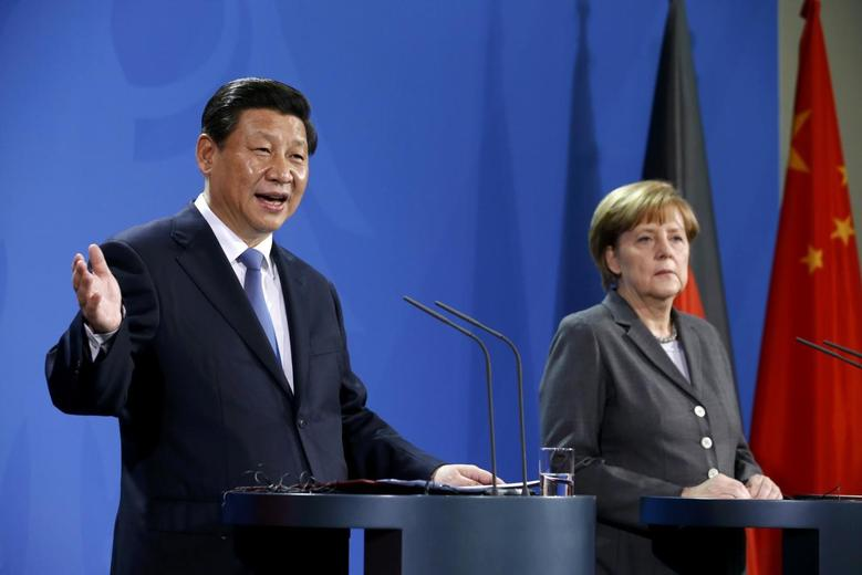 German Chancellor Angela Merkel and China's President Xi Jinping address a joint news conference after an agreement signing, at the Chancellery in Berlin March 28, 2014. REUTERS/Fabrizio Bensch