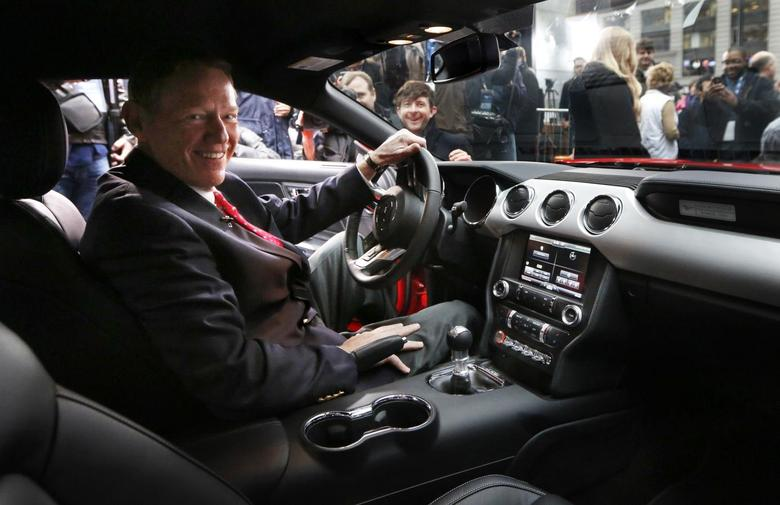 Ford Motor Co. CEO Alan Mulally sits in the driver seat of its all new 2015 Ford Mustang on ABC's Good Morning America in New York December 5, 2013. REUTERS/Brendan McDermid