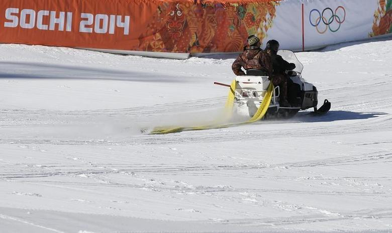 A ski-doo passes by in the finish area of the Alpine Skiing events of the Sochi 2014 Winter Olympic Games in Rosa Khutor February 4, 2014. REUTERS/Leonhard Foeger