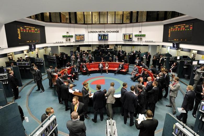 Traders and clerks work at the London Metal Exchange (LME) in London, July 22, 2011. REUTERS/Paul Hackett/Files