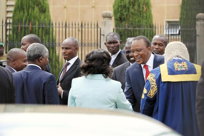 Kenyan President Uhuru Kenyatta (in red tie) is welcomed as he arrives at the Parliament Building to deliver his state of the nation address in Nairobi March 27, 2014. REUTERS/Noor Khamis