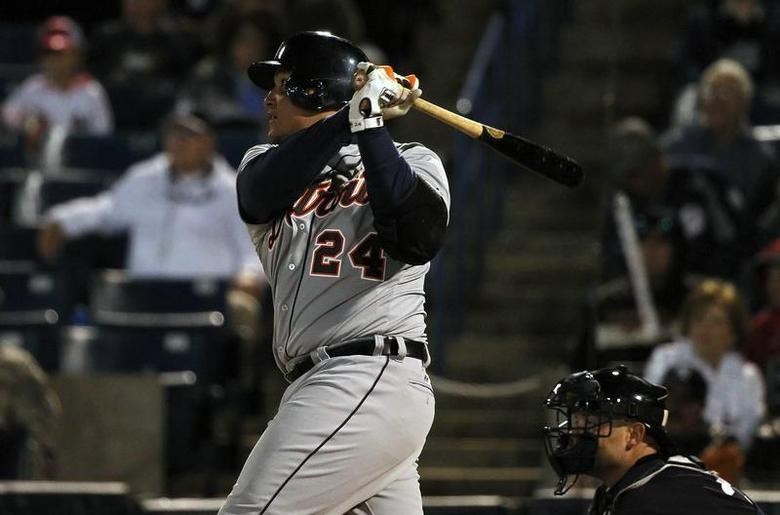 Mar 7, 2014; Tampa, FL, USA; Detroit Tigers first baseman Miguel Cabrera (24) doubles during the first inning against the New York Yankees at George M. Steinbrenner Field. Kim Klement-USA TODAY Sports - RTR3G6TW