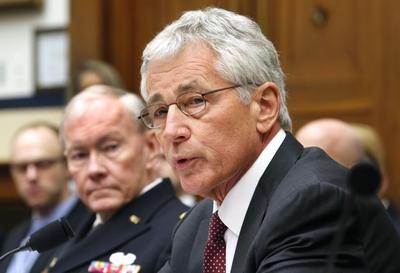 Hagel, ahead of China trip, urges military restraint in cyberspace