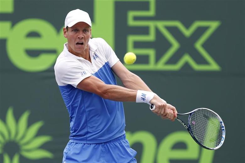 Mar 27, 2014; Miami, FL, USA; Tomas Berdych hits a backhand against Alexandr Dolgopolov (not pictured) on day eleven of the Sony Open at Crandon Tennis Center. Berdych won 6-4, 7-6. Geoff Burke-USA TODAY Sports