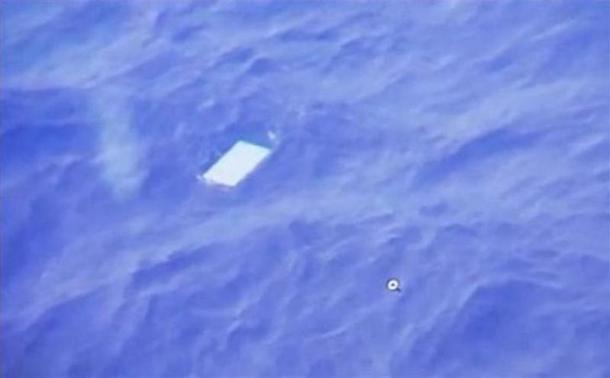 A view of an object floating in the water is seen on a computer screen onboard a Royal New Zealand Air Force (RNAF) plane searching for wreckage from Malaysia Airlines Flight MH370 in the new Indian Ocean search area in this March 28, 2014 still image taken from video. . REUTERS/Pool via Reuters TV