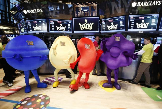 Mascots dressed as characters from the mobile video game ''Candy Crush Saga'' pose during the IPO of Mobile game maker King Digital Entertainment Plc on the floor of the New York Stock Exchange March 26, 2014. REUTERS/Brendan McDermid