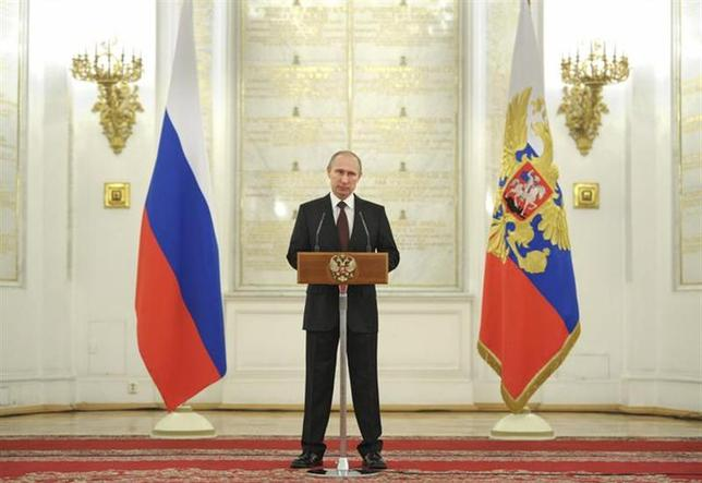 3月28日、オバマ米大統領は、ロシアのプーチン大統領(写真)と電話会談し、米国が提示したウクライナ問題の民主的な解決策をめぐり協議した。モスクワで撮影。提供写真(2014年 ロイター/Alexei Druzhinin/RIA Novosti/Kremlin)