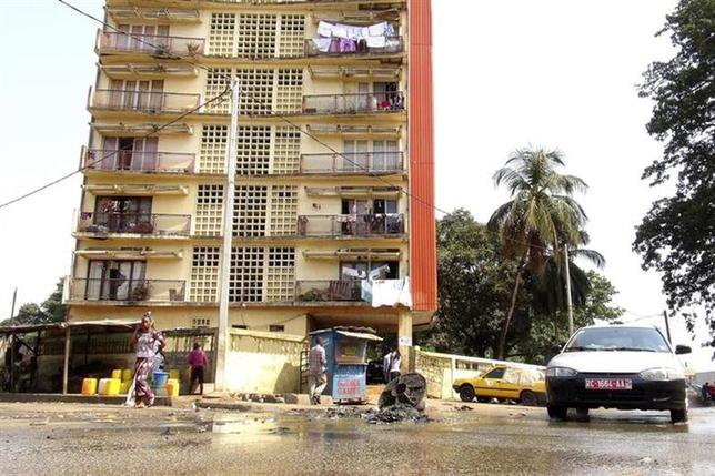 A car drives through sewage water on a street in Conakry, March 25, 2014. REUTERS/Saliou Samb