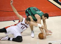 Mar 28, 2014; Toronto, Ontario, CAN; Boston Celtics forward Kris Humphries (43) wins a battle for the ball against Toronto Raptors center Jonas Valanciunas (17) at Air Canada Centre. The Raptors beat the Celtics 105-103. Mandatory Credit: Tom Szczerbowski-USA TODAY Sports