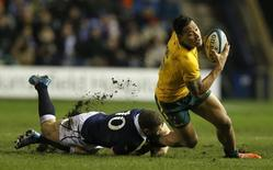 Australia's Israel Folau is tackled by Scotland's Duncan Weir during their rugby union international test match at Murrayfield Stadium in Edinburgh Scotland, November 23, 2013. REUTERS/Russell Cheyne