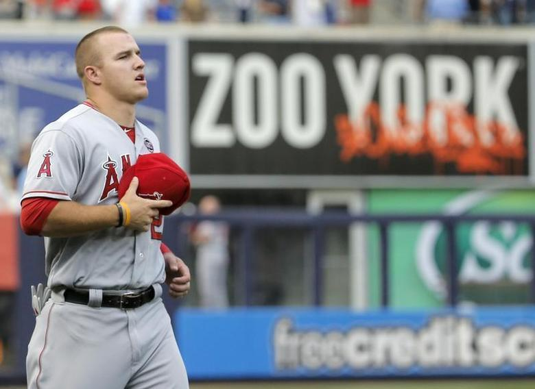 Los Angeles Angels center fielder Mike Trout runs past an outfield sign before playing the New York Yankees in their MLB American League game at Yankee Stadium in New York, August 12, 2013. REUTERS/Ray Stubblebine