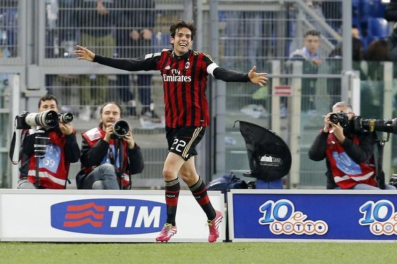 AC Milan's Ricardo Kaka celebrates after scoring against Lazio during their Italian Serie A soccer match at the Olympic stadium in Rome March 23, 2014. REUTERS/Giampiero Sposito