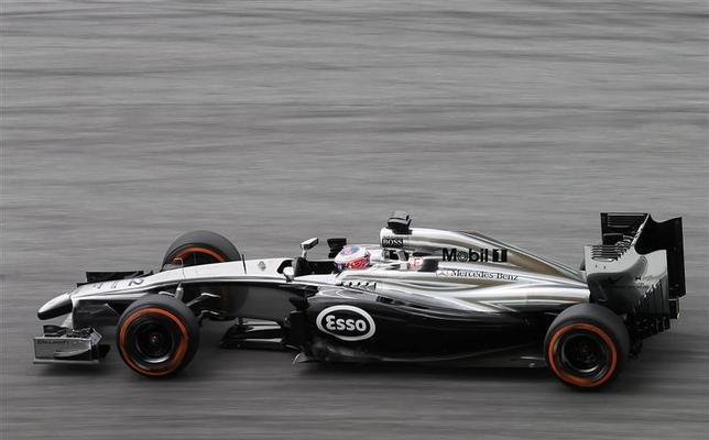 McLaren Formula One driver Jenson Button of Britain drives during the third practice session of the Malaysian F1 Grand Prix at Sepang International Circuit outside Kuala Lumpur, March 29, 2014. REUTERS/Samsul Said
