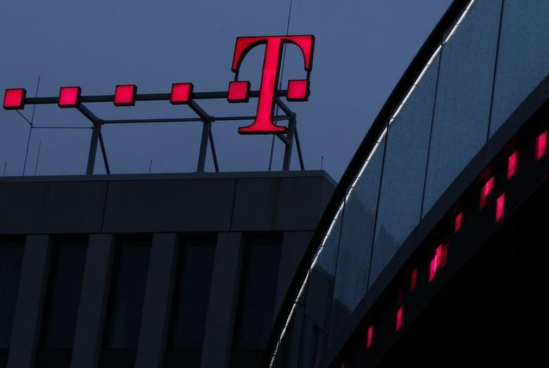 The logo of Deutsche Telekom AG is pictured at their headquarters, in this file photo taken in Bonn December 5, 2012. REUTERS/Ina Fassbender/Files