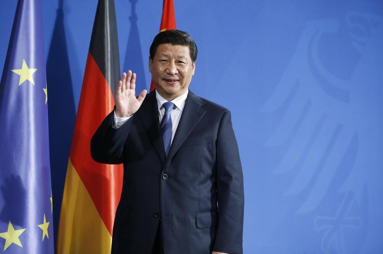 China's President Xi Jinping waves to media following a joint news conference with German Chancellor Angela Merkel after an agreement signing, at the Chancellery in Berlin March 28, 2014. REUTERS/Fabrizio Bensch