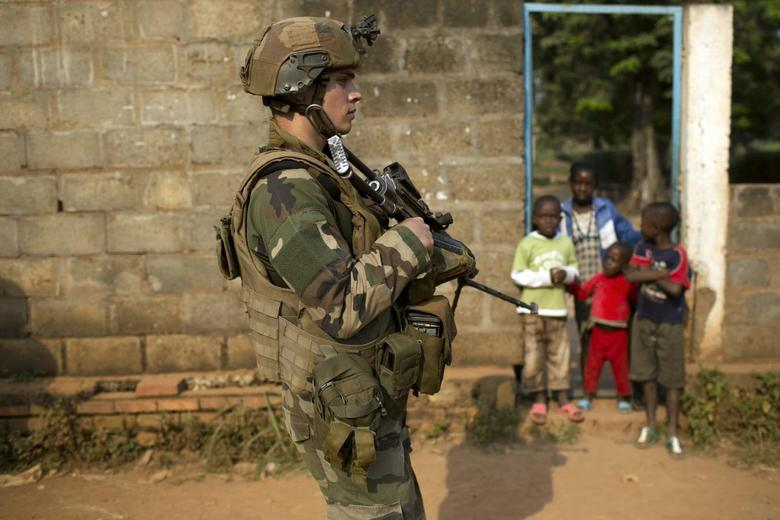 A French peacekeeping soldier patrols a street of the capital Bangui January 18,2014 file photo. REUTERS/Siegfried Modola