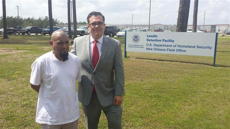 Mario Vargas-Lopez (L) stands with his attorney Alex Galvez shortly after his release from Lasalle Detention facility in Jenna, Louisiana March 28, 2014 in this picture provided by Galvez. REUTERS/Alex Galvez/Handout via Reuters
