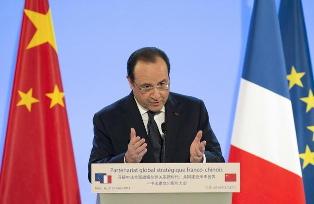 French President Francois Hollande delivers a speech to mark fifty years of diplomatic relations between France and China at the French Foreign Ministry in Paris March 27, 2014. REUTERS/Alain Jocard/Pool