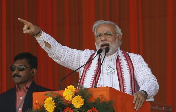 Narendra Modi, prime ministerial candidate for Bharatiya Janata Party (BJP) and Gujarat's chief minister, addresses his supporters during a rally in Amroha, Uttar Pradesh March 29, 2014. REUTERS/Adnan Abidi