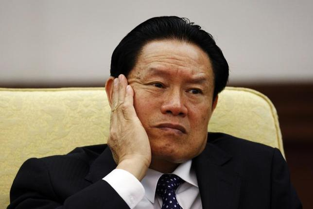 Then China's Public Security Minister Zhou Yongkang reacts as he attends the Hebei delegation discussion sessions at the 17th National Congress of the Communist Party of China at the Great Hall of the People, in Beijing October 16, 2007. REUTERS/Jason Lee/Files