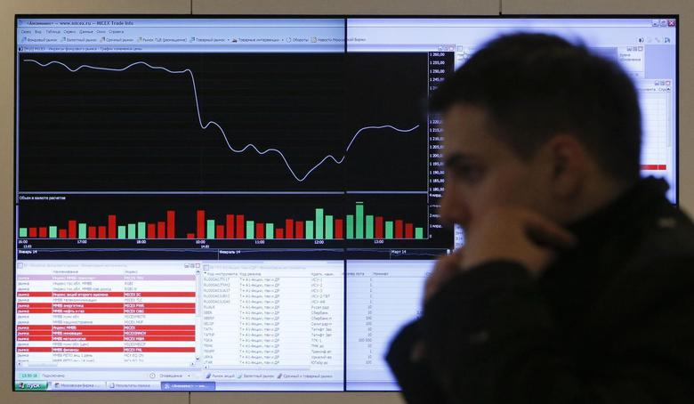 A man walks past an information screen on display inside the office of the Moscow Exchange in the capital Moscow March 14, 2014. REUTERS/Maxim Shemetov