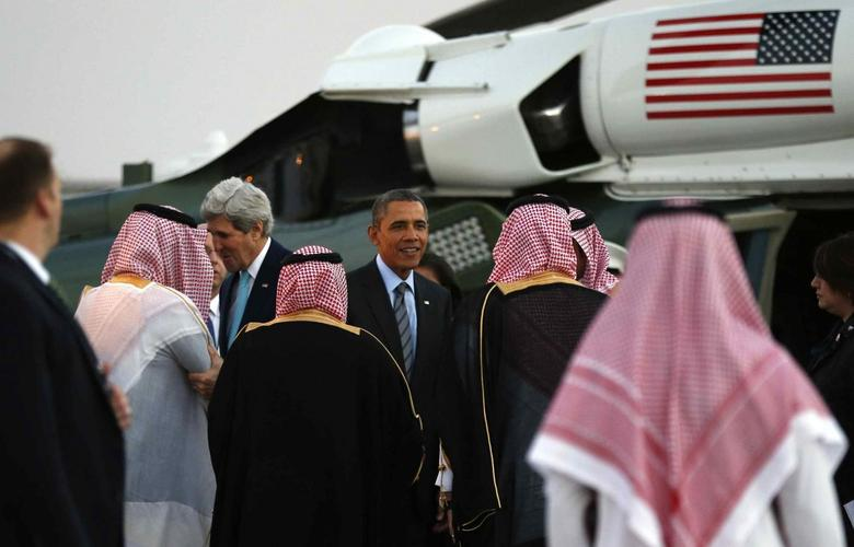 U.S. Secretary of State John Kerry (L) and U.S. President Barack Obama are greeted upon their arrival on Marine One for a meeting with Saudi King Abdullah at Rawdat al-Khraim (Desert Camp) near Riyadh in Saudi Arabia, March 28, 2014. REUTERS/Kevin Lamarque