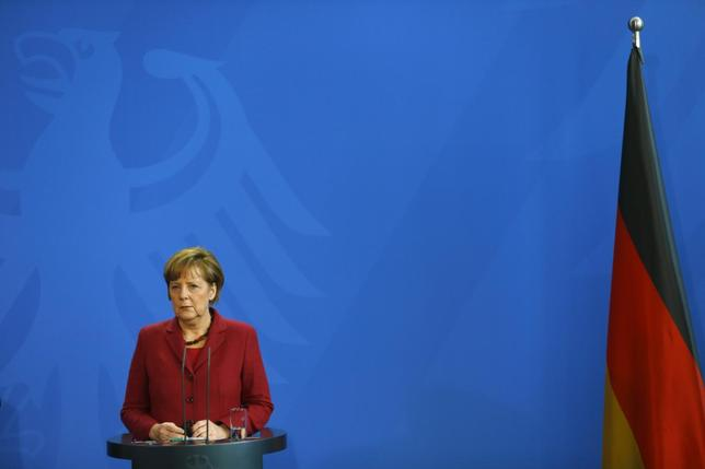 German Chancellor Angela Merkel listens to Canadian Prime Minister Stephen Harper (not pictured) during a joint news conference at the Chancellery in Berlin March 27, 2014. REUTERS/Kai Pfaffenbach