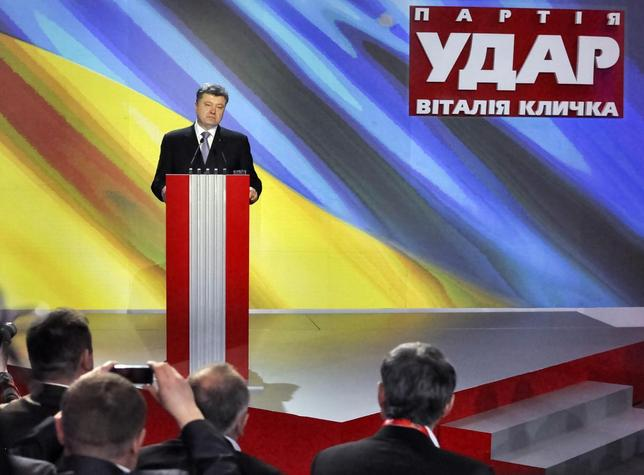Ukrainian politician Petro Poroshenko addresses members of an UDAR (Punch) party during a meeting in Kiev March 29, 2014. REUTERS/Viktor Gurniak