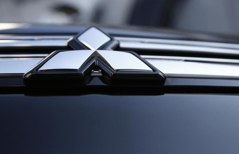 The logo of Mitsubishi Motors is seen on the front part of the company's car at the company showroom in Tokyo November 6, 2013. REUTERS/Issei Kato